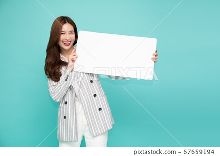 Young asian woman showing and holding blank white billboard 67659194