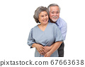 Asian senior couple hugging together isolated over white background 67663638