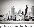 Business concept of risk support and assistance with man balancing on rope 67666747
