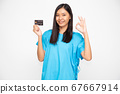 Young Asian beautiful woman patient holding  personal accident insurance credit card and ok sign. 67667914