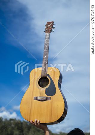 Guitar and blue sky. 67671445