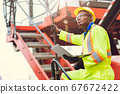 Black African Staff foreman intend to work loading worker using laptop computer 67672422