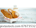 Sourdough Bread and starter dough fresh baked bread in basket with chocolate milk bottle 67673532