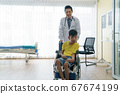People with disabilities are consulting a doctor. 67674199