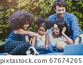 Family activity outdoor at home backyard happy enjoy funny moment during Stay home Self quarantine 67674265