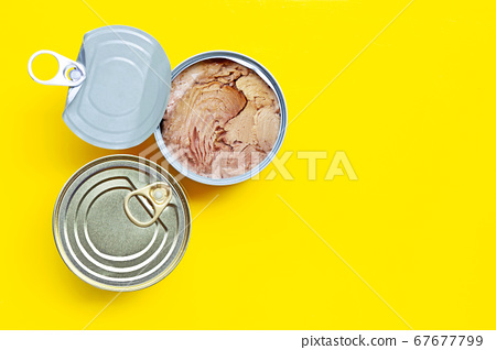 Canned tuna fish on yellow background. 67677799