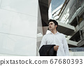 Businessman in the city. Bangkok. 67680393
