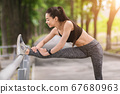 Stretching Outdoors. Sporty Asian Female Warming Up Muscles Before Training In Park 67680963