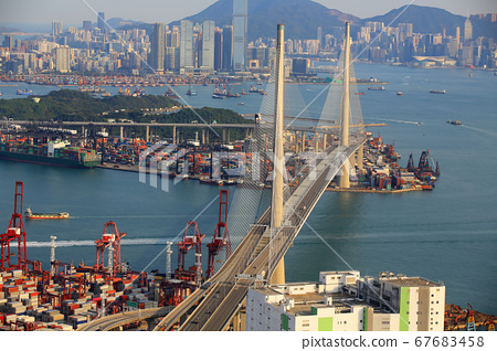 Kwai Tsing container terminal port view in drone, and hong kong skyline and stonecutter's bridge 67683458