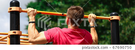 Man working out in park 67690750