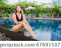 Portrait beautiful young asian woman leisure relax smile around outdoor swimming pool 67691507