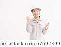 Female tablet in work clothes 67692399