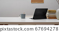 Home office desk with digital tablet, stack of 67694278
