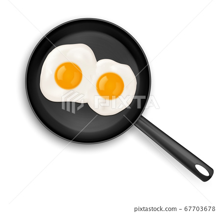 Fried eggs on frying pan top view isolated food 67703678