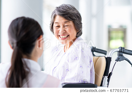 Senior women and caregivers in nursing homes 67703771