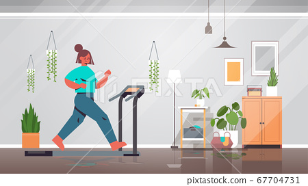 woman running on treadmill at home girl having workout cardio fitness training healthy lifestyle home sport 67704731