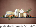 Various soft cheeses with walnuts and rosemary. 67706425