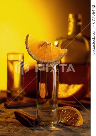 Tequila with orange and cinnamon. 67706442