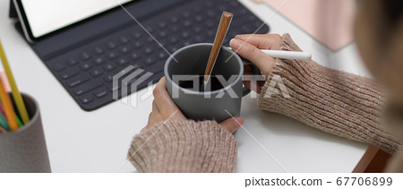 Female office worker take break with a cup of hot 67706899
