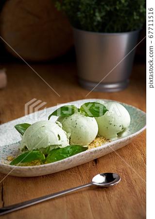 Homemade ice cream from green basil 67711516