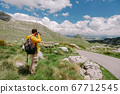 travel photographer in mountains 67712545