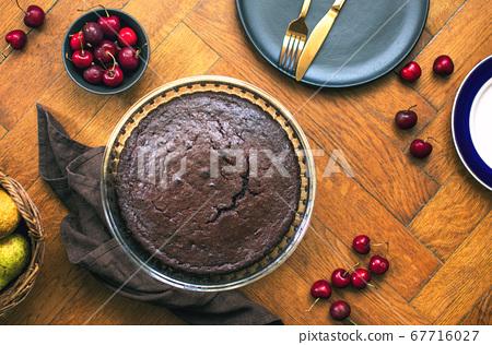 Home baked dark chocolate pie with cweet cherries 67716027