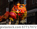 Dragon dance lit up by the sunshine 67717072