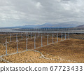 Aerial view of huge array of gigantic wind turbines spreading over the desert in Palm Springs. 67723433