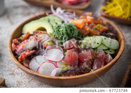 deluxe poke bowl with tuna, octopus and salmon 67723786