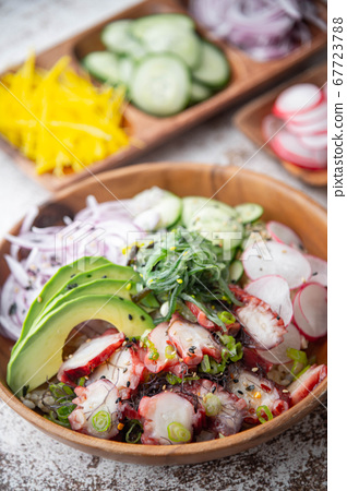 colorful octopus poke bowl with vegetables 67723788
