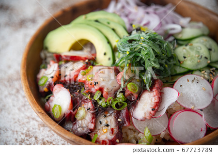 colorful octopus poke bowl with vegetables 67723789