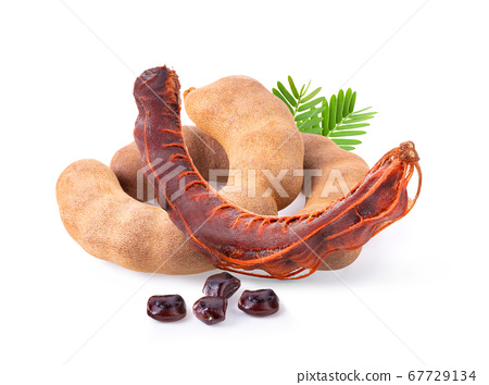 ripe tamarind with leaf isolated on white 67729134
