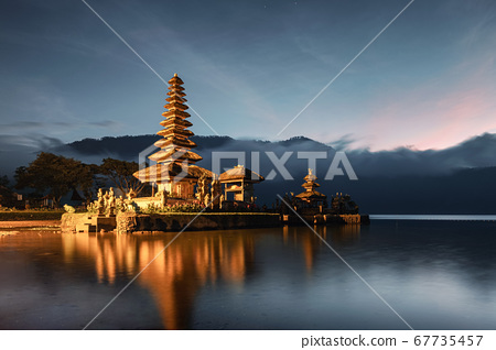 Ancient temple illumination of Pura Ulun Danu 67735457