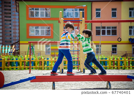 Two little school and preschool kids boys playing 67740401