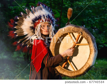 Female shaman in native American Indian clothes 67740584