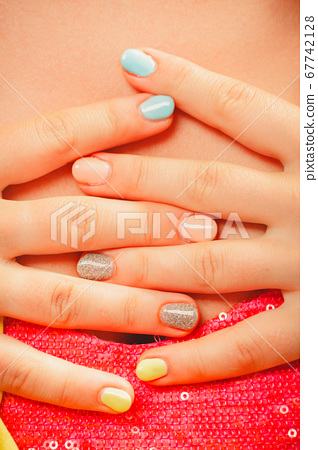 Woman hands with color nail polish. Manicure. 67742128