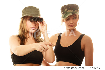 Two women in military clothes with binoculars army 67742570