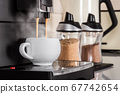 ceramic Cup of coffee Prepared on the coffee machine 67742654
