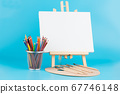 Easel, pencils and brushes 67746148