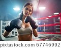 Woman posing in boxing gloves. 67746992