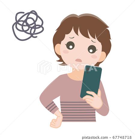 스마트 폰을보고 어려움을 겪고있는 여성 67748718