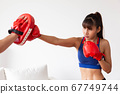 An asian women has boxing training with trainer by 67749744