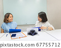 Business team members discuss about work at workplace 67755712