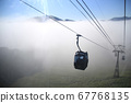 Gondola advancing in the sea of clouds 67768135