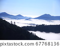Beautiful silhouetted trees floating in the sea of clouds 67768136