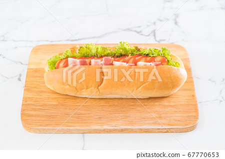 sausage hotdog with ketchup 67770653