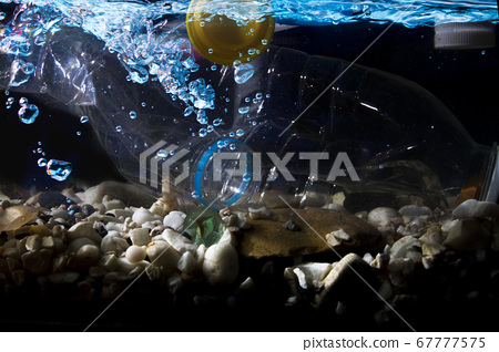 Plastic waste, water bottles are dumped into the river, the problem of world waste 67777575