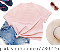 Mockup of a pink t-shirt placed between some beach 67780226