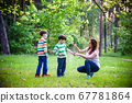 Young woman mother applying insect repellent to 67781864