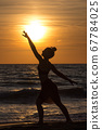 Lonely Dancer ballet posing on the beach sunset silhouette sea 67784025